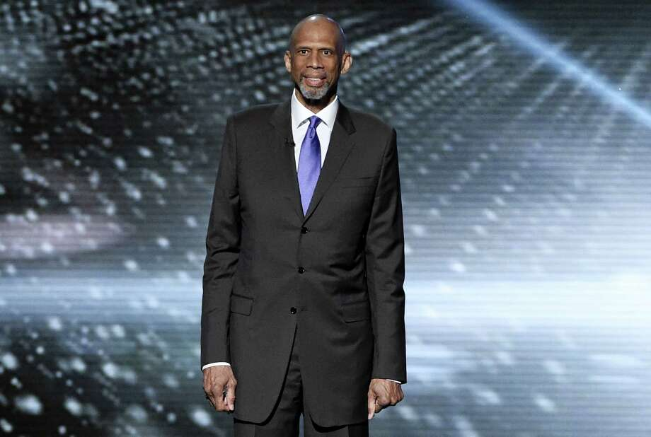 In this July 13, 2016 photo, Kareem Abdul-Jabbar presents a tribute to Muhammad Ali at the ESPY Awards at the Microsoft Theater in Los Angeles. Abdul-Jabbar's next book will be a fond look back at his long friendship with John Wooden, the celebrated basketball coach at UCLA. Photo: Photo By Chris Pizzello/Invision/AP, File   / Invision