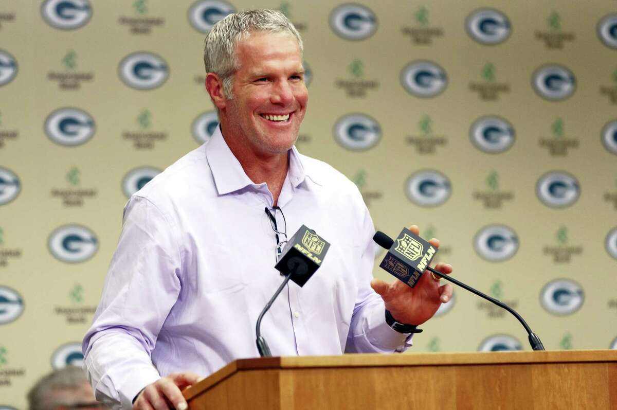 Former Green Bay Packers NFL football quarterback Brett Favre smiles at a news conference prior to being inducted into the Packers Hall of Fame and having his No. 4 jersey retired on July 18, 2015, at Lambeau Field in Green Bay, Wis.