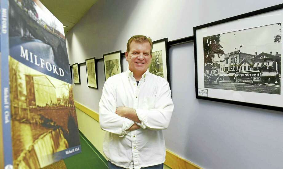 """Michel F. Clark of Madison, who grew up in Milford, author of the book, """"Milford Then and Now,"""" at the Milford Library Thursday. Photo: Peter Hvizdak — New Haven Register   / ?2016 Peter Hvizdak"""