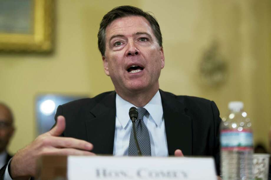 In this July 14, 2016, file photo, FBI Director James Comey testifies on Capitol Hill in Washington. The FBI informed Congress Friday, Oct. 28, 2016, it is investigating whether there is classified information in new emails that have emerged in its probe of Hillary Clinton's private server. The FBI said in July its investigation was finished. Photo: AP Photo/Evan Vucci, File    / Copyright 2016 The Associated Press. All rights reserved. This material may not be published, broadcast, rewritten or redistribu