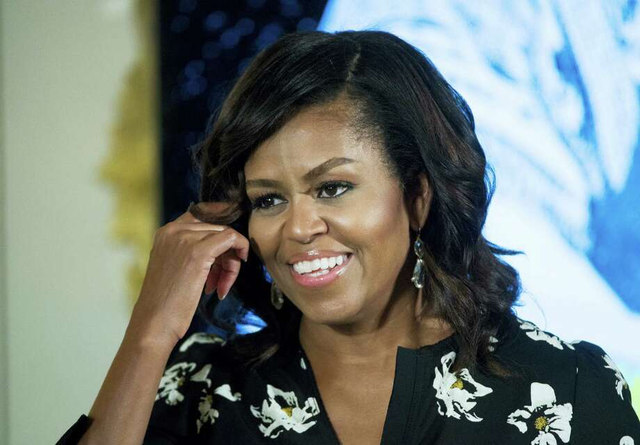 First lady Michelle Obama speaks in Washington earlier this month. The first lady is taking part in a commissioning ceremony for the U.S. Navy attack submarine named for her home state of Illinois. The submarine officially becomes the USS Illinois and begins active service at a ceremony Saturday, Oct. 29, 2016, in Groton. Photo: Molly Riley — AP File Photo    / Molly Riley