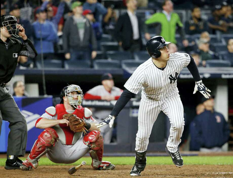 Boston Red Sox catcher Bryan Holaday watches along with New York'S Mark Teixeira, who hit a ninth-inning, walk-off grand slam to defeat the Boston Red Sox 5-3 Wednesday. Photo: KATHY WILLENS — THE ASSOCIATED PRESS   / Copyright 2016 The Associated Press. All rights reserved.