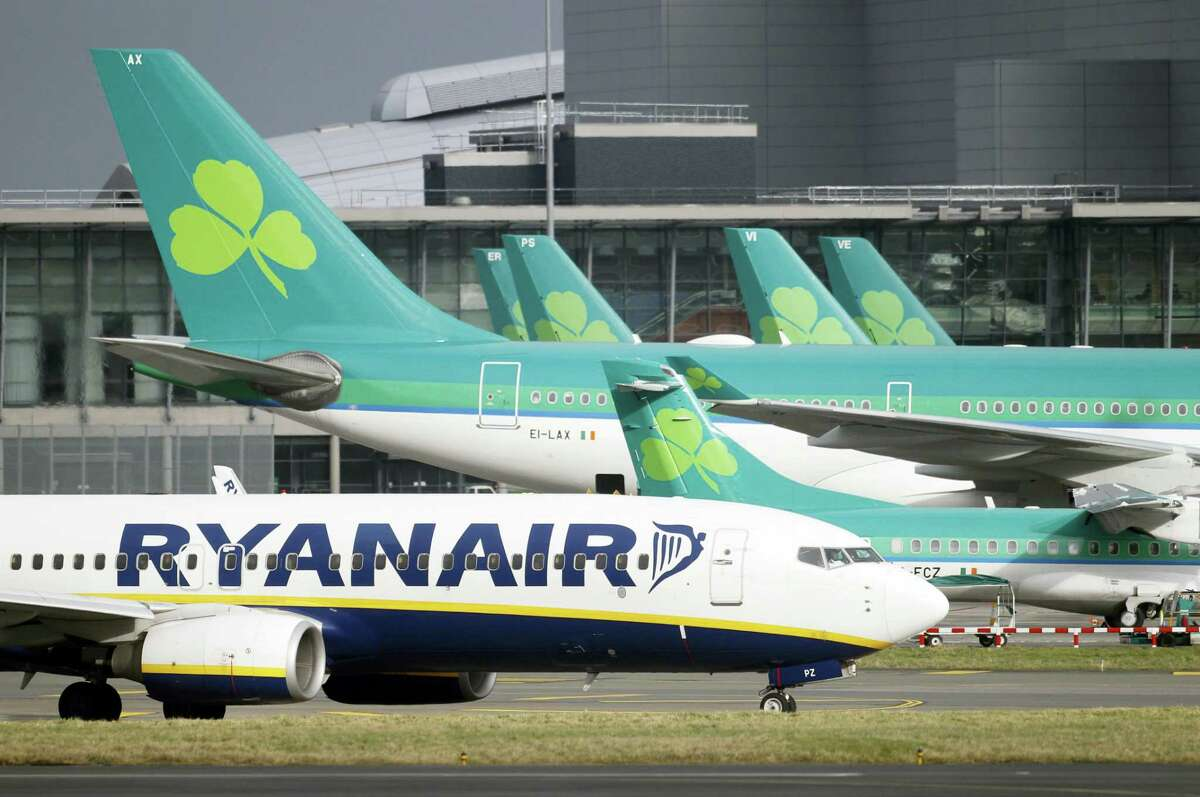 A Jan. 27, 2015 photo shows Aer Lingus planes standing on the tarmac with a Ryanair plane at Dublin airport, Ireland.