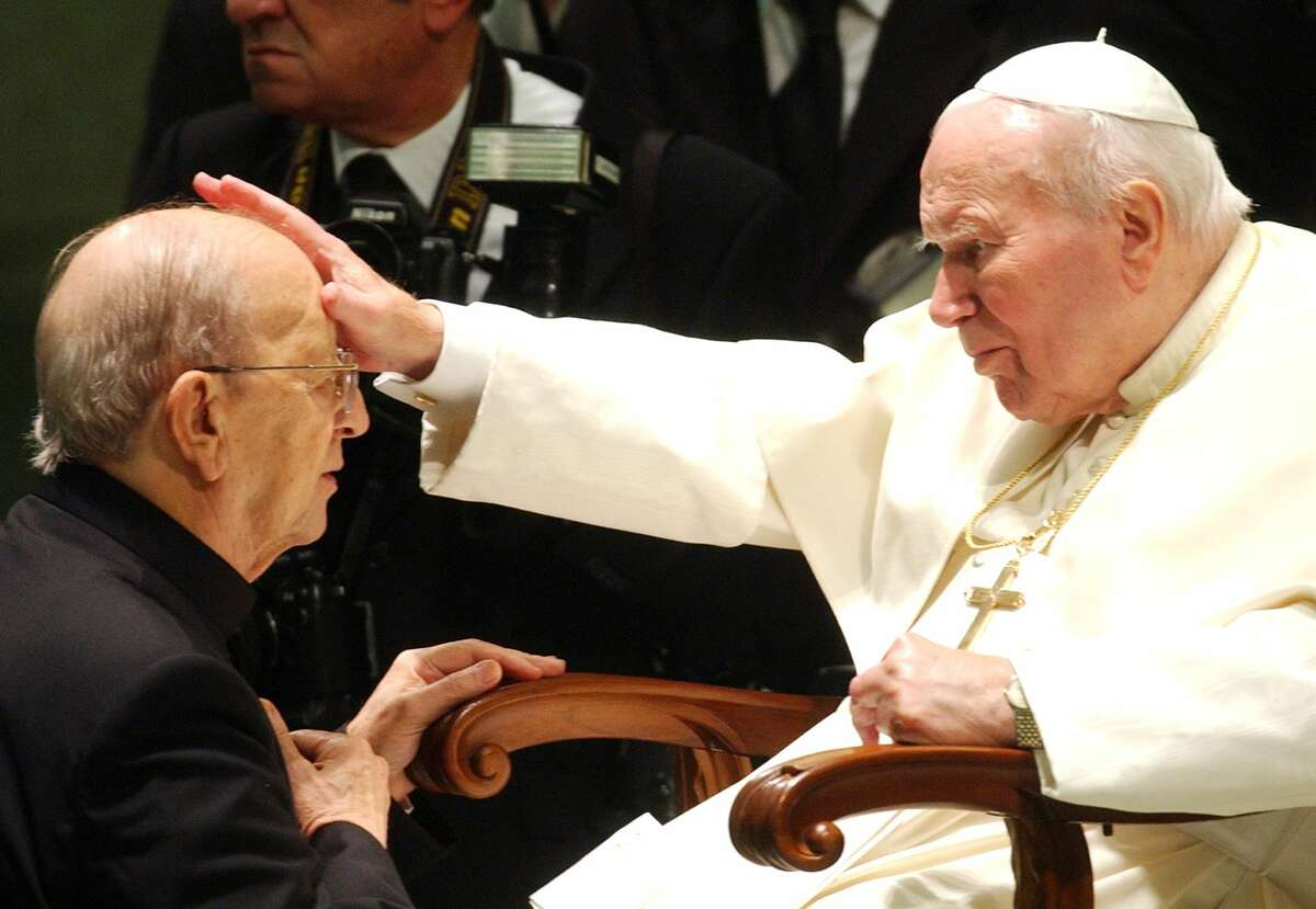 In this Nov. 30, 2004, file photo, the late Pope John Paul II gives his blessing to the late Rev. Marcial Maciel, founder of Christ's Legionaries, during a special audience the pontiff granted to about four thousand participants of the Regnum Christi movement, at the Vatican.The Vatican is investigating seven priests from the troubled Legion of Christ religious order for alleged sexual abuse of minors and another two for other alleged crimes, The Associated Press has learned. At one time, before the charges against Maciel were proven, the Vatican had held him up as a role model.