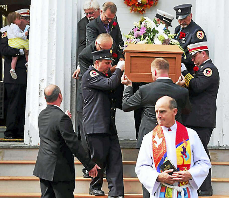 Funeral of North Madison Volunteer Fire Company firefighter Amanda Bernier, 32 , at the North Madison Congregational Church Tuesday, September 27, 2016. Bernier died battling ALS. Photo: Peter Hvizdak­ — New Haven Register