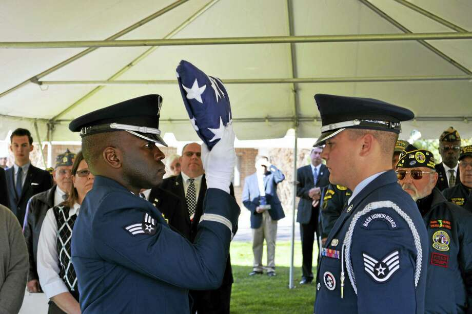 Naval Clerk Jack Andrew Lunich and Airman 3rd Class George Louis Duefield, both of Danbury, were posthumously awarded the Connecticut Wartime Service Medal before their interment at the State Veterans Cemetery in Middletown on Friday. Photo: Cassandra Day — The Middletown Press