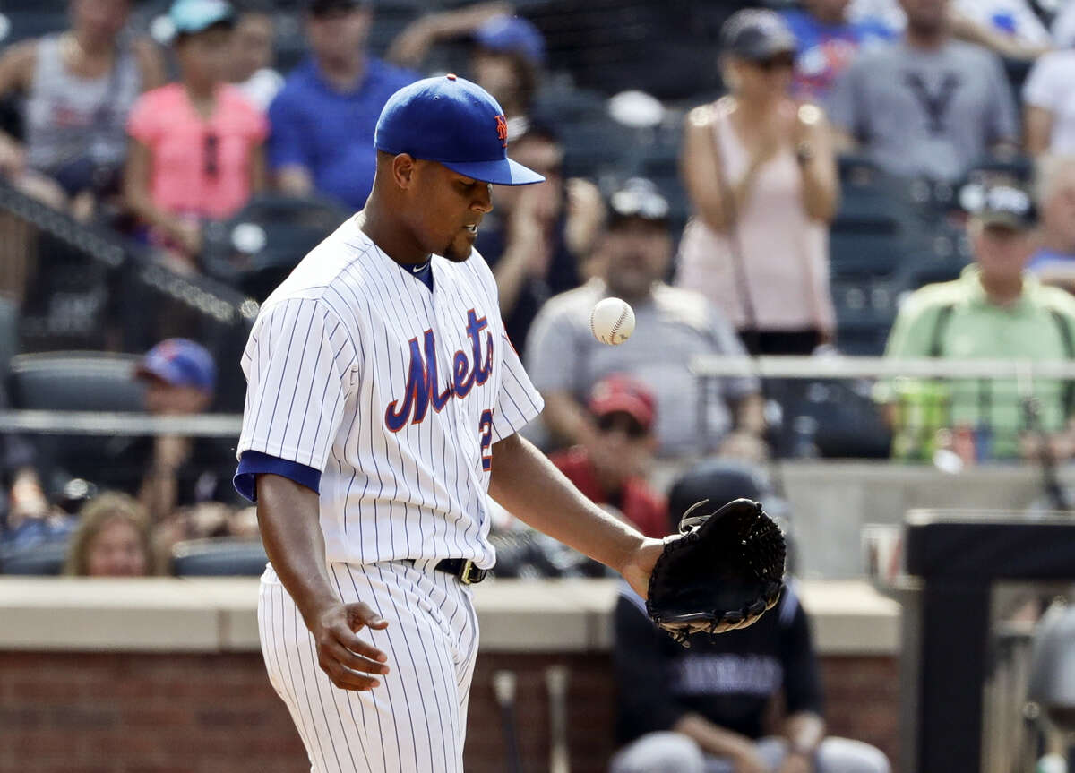 New York Mets relief pitcher Jeurys Familia reacts after a run scored on a wild pitch during the ninth inning against the Colorado Rockies Thursday. The Rockies beat the Mets 2-1.