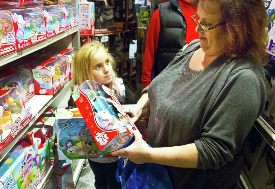 "In this Nov. 27, 2015, photo, Cinnamon Boffa, right, from Bensalem, Pa., checks out a ""Chubby Puppies"" toy for her daughter Serenity, left, at a Toys R Us in New York. Photo: Bebeto Matthews — THE ASSOCIATED PRESS FILE PHOTO   / Copyright 2016 The Associated Press. All rights reserved."