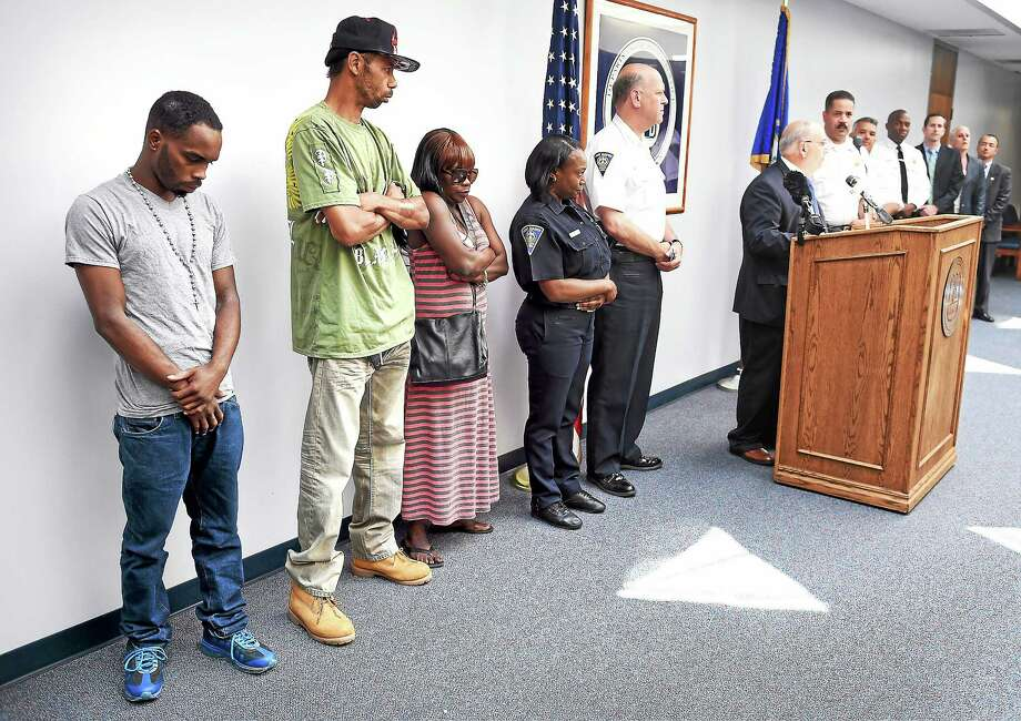This 2014 photo shows, from left, Tyreese Jones' brother, William Jowers, and his parents, Jymeson and Felicia Jones, as the New Haven Police Department announced the arrest of Errol Godfrey-Hill in the shooting death of Tyreese Jones. Photo: Arnold Gold — New Haven Register