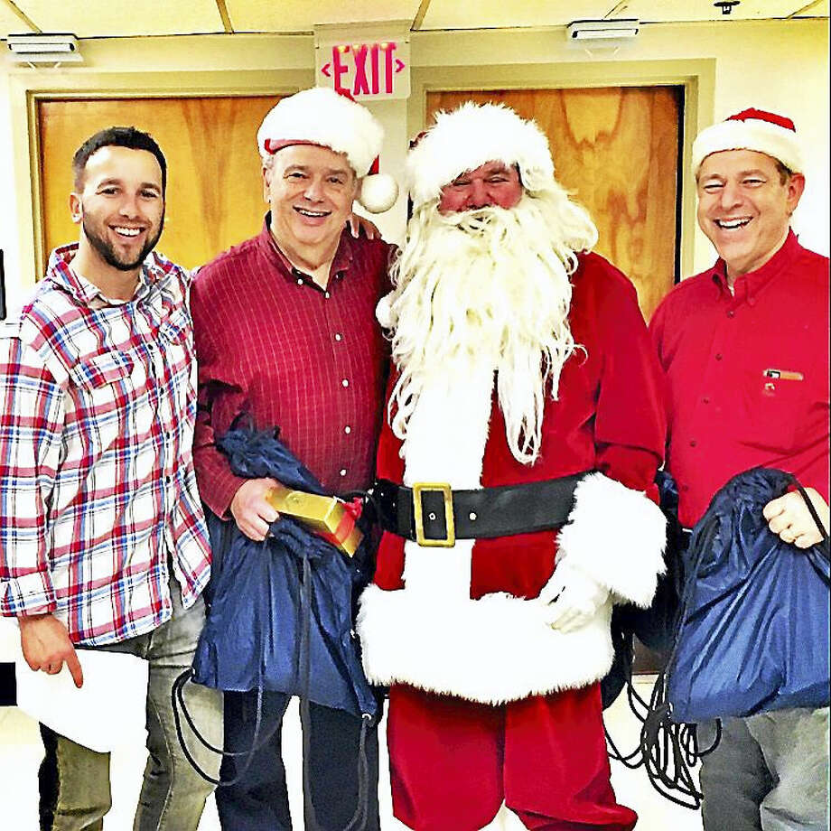 From left, Steven Miller, Harold Miller, Mike Romeo (Santa), and Jerry Gruenbaum volunteer at a past B'nai B'birth Christmas Eve celebration at the Veternas Affairs medical center. Photo: Contributed Photo