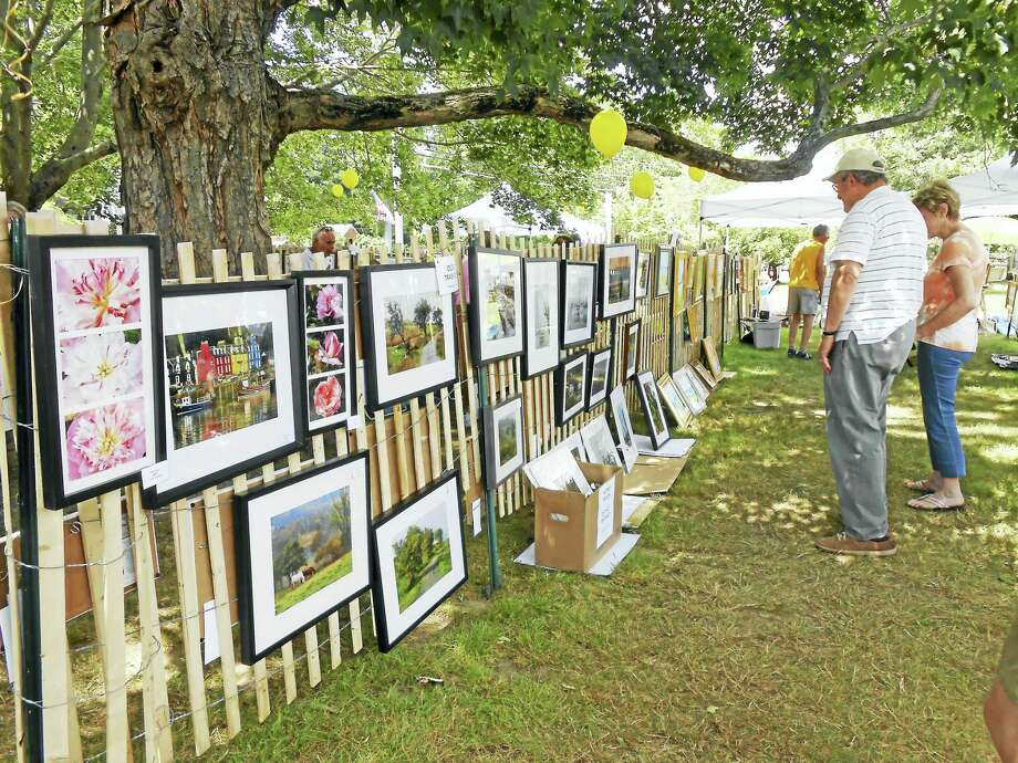 Artwork lines the fences of the show in Old Lyme. Photo: Contributed