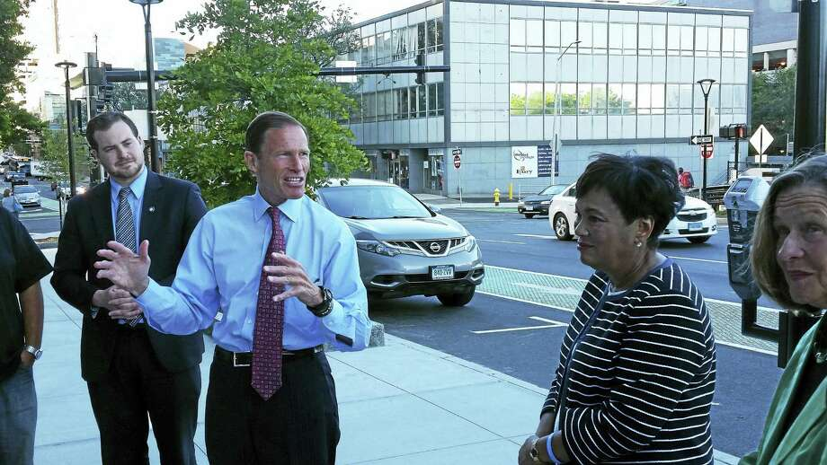 Sen. Richard Blumenthal and New Haven Mayor Toni Harp led a group of city officials on a tour of sites being developed around downtown that will help connect outlying areas with downtown. Photo: Journal Register Co.