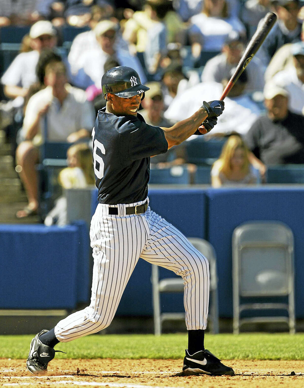 New York Yankees' Doug Glanville swings through during one of his four at bats against the Philadelphia Phillies in 2005 at Legends Field in Tampa, Fla. Connecticut Gov. Dannel P. Malloy appointed Glanville to serve on the Connecticut commission responsible for enforcing professional standards for certifying police officers.