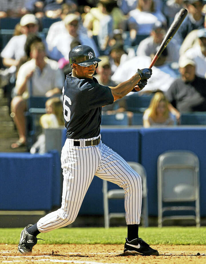 New York Yankees' Doug Glanville swings through during one of his four at bats against the Philadelphia Phillies in 2005 at Legends Field in Tampa, Fla. Connecticut Gov. Dannel P. Malloy appointed Glanville to serve on the Connecticut commission responsible for enforcing professional standards for certifying police officers. Photo: Kathy Willens — AP File Photo / AP2005