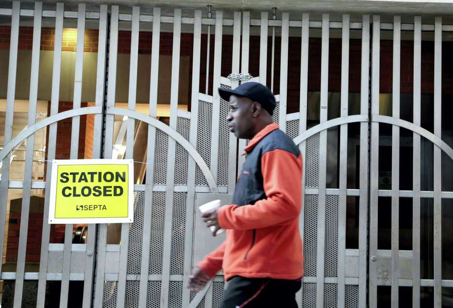 A pedestrian passes a locked rail station in west Philadelphia Tuesday. Photo: Jacqueline Larma — The Associated Press   / Copyright 2016 The Associated Press. All rights reserved.