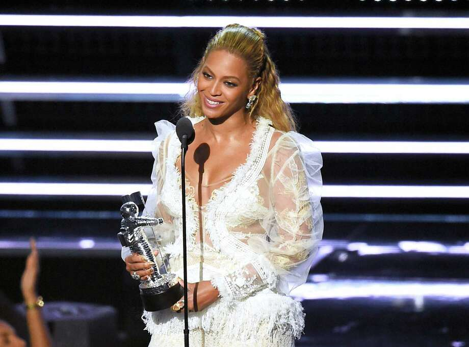 "Beyonce accepts the award for Video of the Year for ""Lemonade"" at the MTV Video Music Awards at Madison Square Garden on Sunday, Aug. 28, 2016, in New York. Photo: Photo By Charles Sykes/Invision/AP   / Invision"