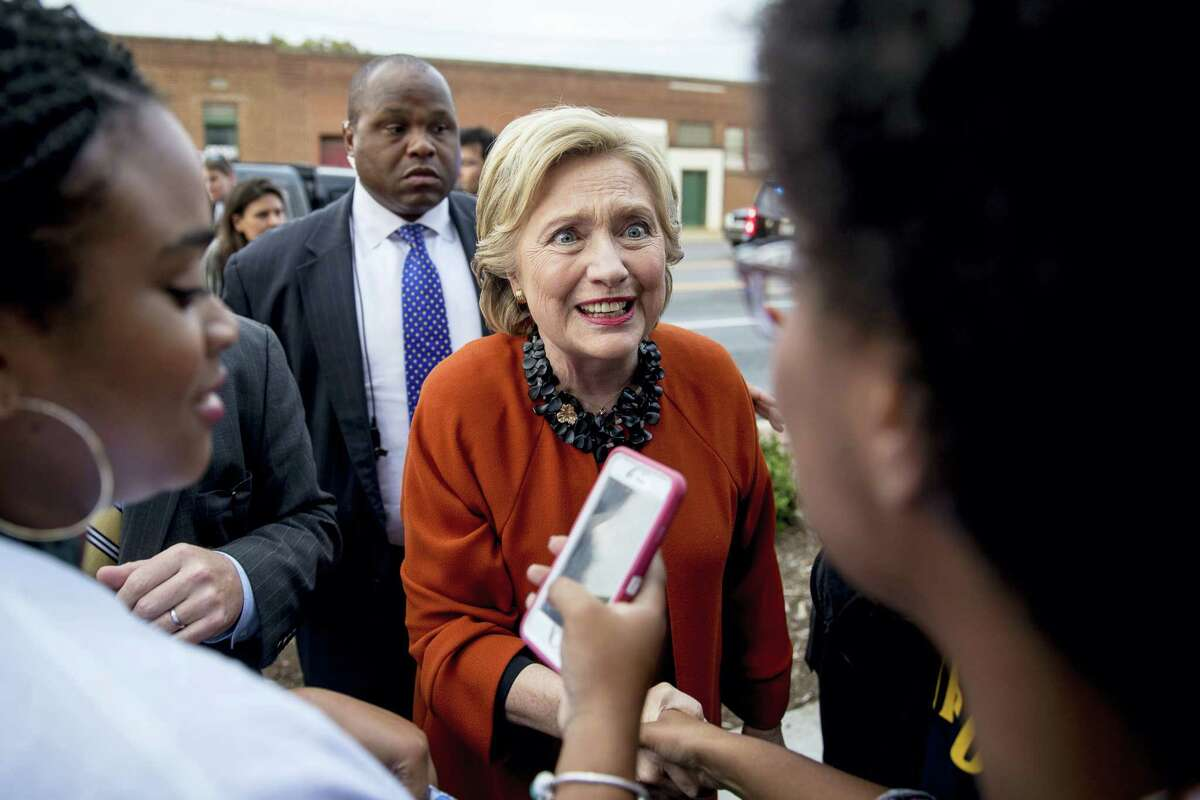 Democratic presidential candidate Hillary Clinton greets early voters at the Leonard J. Kaplan Center for Wellness at the University of North Carolina at Greensboro in Greensboro, N.C., Thursday, Oct. 27, 2016.
