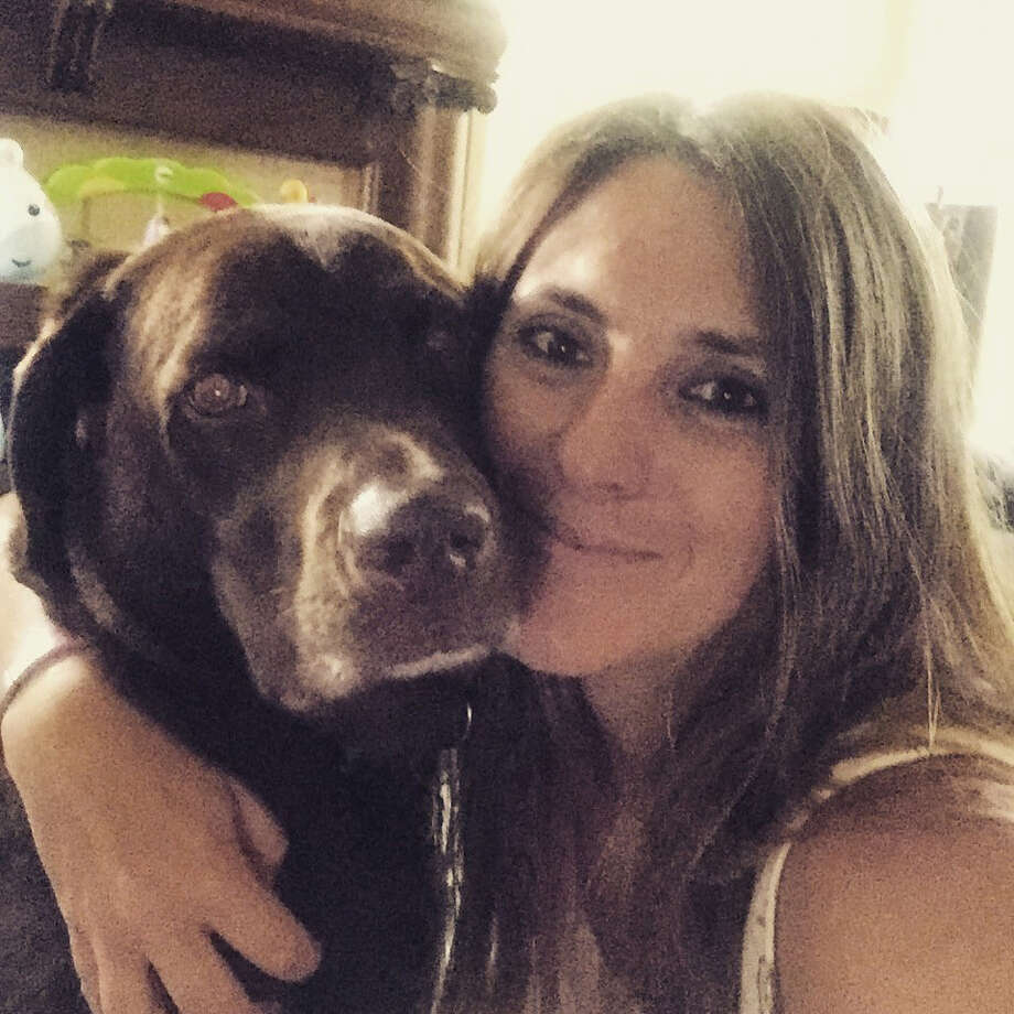 Lisa McCombs says she was barred from boarding multiple American Airlines flights because she was traveling with her service dog, Jake. Photo: Courtesy Of Lisa McCombs / The Washington Post