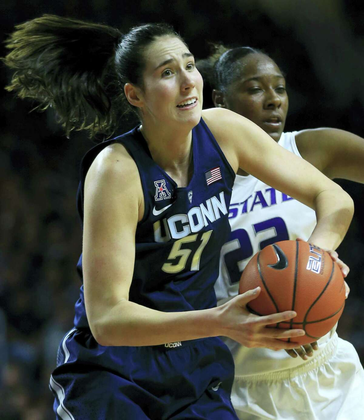 Connecticut center Natalie Butler (51) rebounds in front of Kansas State forward Breanna Lewis (22) during the first half of an NCAA college basketball game in Manhattan, Kan. on Sunday, Dec. 11, 2016.