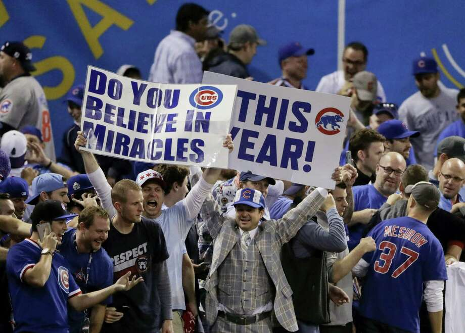 Fans react after the Chicago Cubs won Game 7 of the Major League Baseball World Series against the Cleveland Indians Thursday, Nov. 3, 2016 in Cleveland. The Cubs won 8-7 in 10 innings to win the series 4-3. Photo: AP Photo/Charlie Riedel   / Copyright 2016 The Associated Press. All rights reserved.