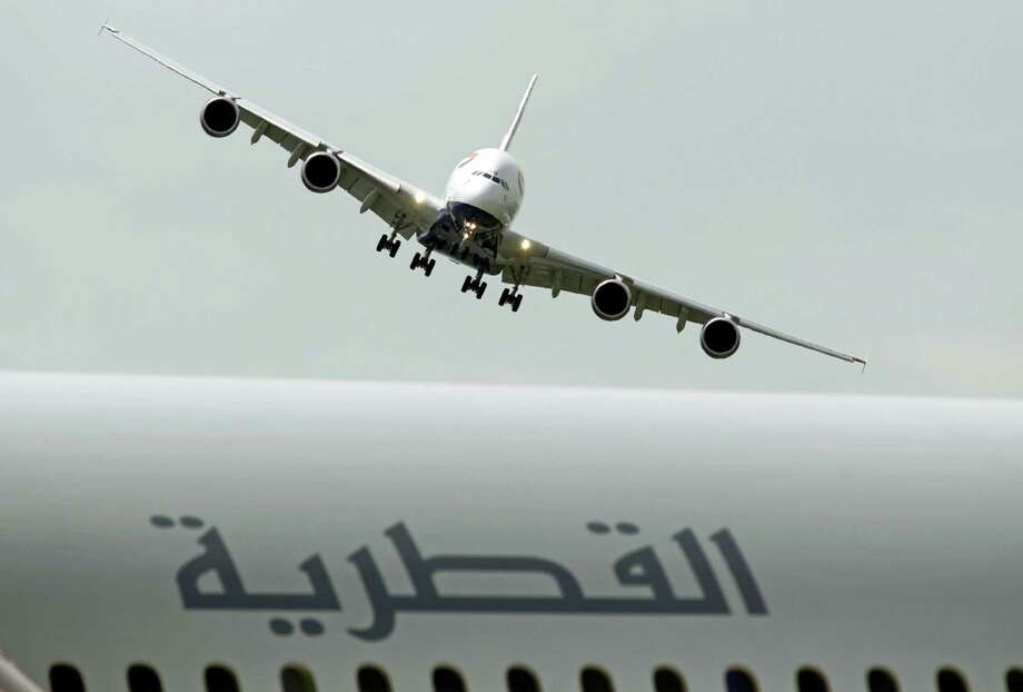 In this Tuesday June 18, 2013, file photo, a British Airways Airbus A380 prepares to land after performing its demonstration flight, at the 50th Paris Air Show at Le Bourget airport, north of Paris. Photo: AP Photo/Remy De La Mauviniere, File    / Copyright 2016 The Associated Press. All rights reserved.
