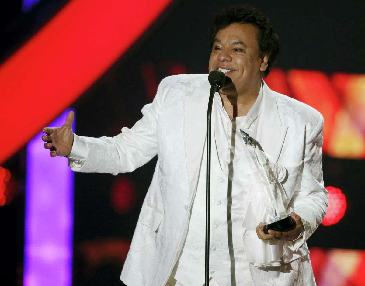 In this April 28, 2016 photo, singer Juan Gabriel receives the Star Award at the Latin Billboard Awards, in Coral Gables, Fla. Representatives of Juan Gabriel have reported Sunday, Aug. 28, 2016, that he has died. Gabriel was Mexico's leading singer-songwriter and top-selling artist with sales of more than 100 million albums.