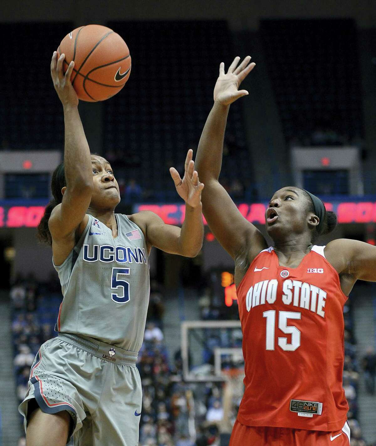UConn's Crystal Dangerfield shoots as Ohio State's Linnae Harper defends, in the first half.