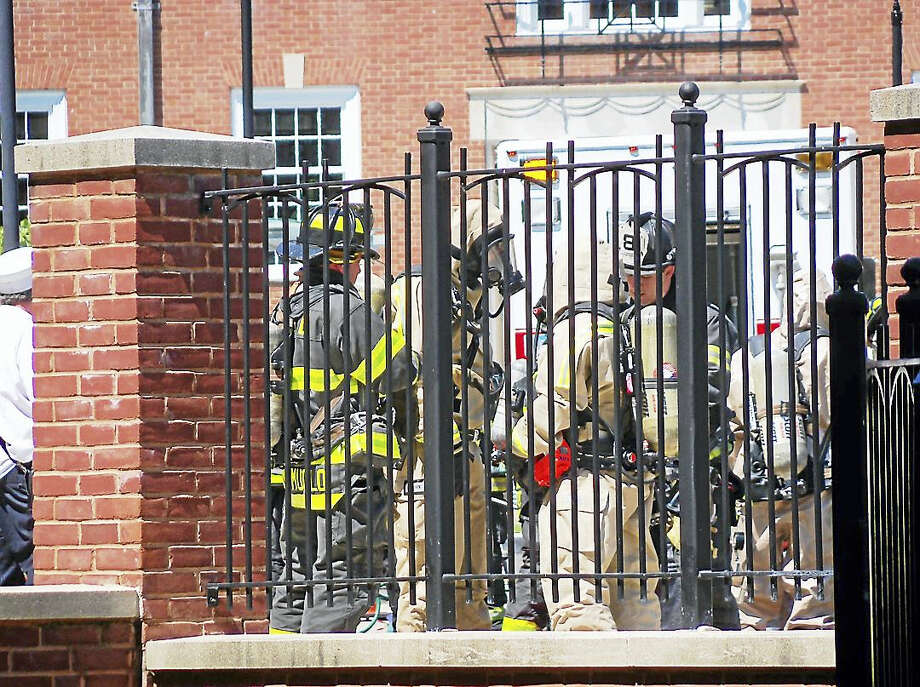 The Johnson Laboratory on Huntington Street in New Haven was evacuated Thursday after an unknown liquid was found leaking from a package in its basement. Photo: Wes Duplantier — The New Haven Register