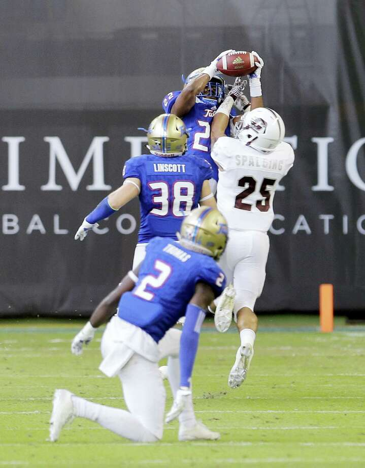 Tulsa safety Jeremy Brady (22) intercepts a pass intended for Central Michigan running back Devon Spalding (25) in the first half of the Miami Beach Bowl. Tulsa beat Central Michigan 55-10. Photo: ALAN DIAZ — The Associated Press   / Copyright 2016 The Associated Press. All rights reserved.