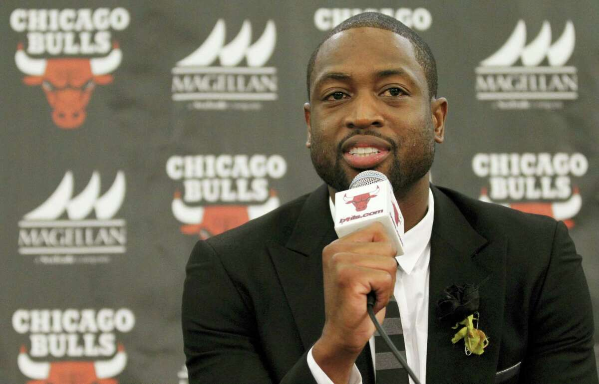 In this July 29, 2016 photo, Chicago Bulls player Dwyane Wade speaks during a news conference in Chicago. A family spokesman says a cousin of Wade's was fatally shot Aug. 25, 2016 while pushing a baby in a stroller on the city's South Side.