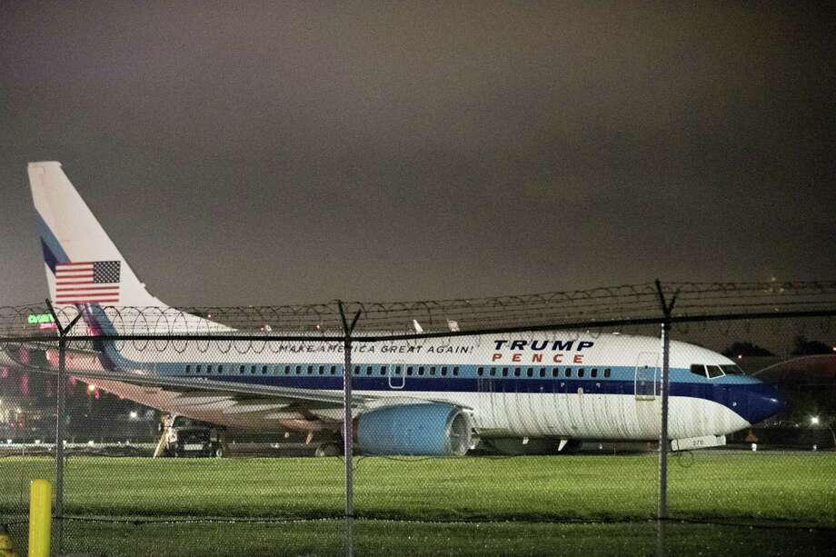 Republican vice presidential candidate Indiana Gov. Mike Pence's campaign airplane sits partially on the tarmac and the grass after sliding off the runway while landing at LaGuardia airport, Thursday, Oct. 27, 2016, in New York. Photo: AP Photo/Mary Altaffer    / Copyright 2016 The Associated Press. All rights reserved.