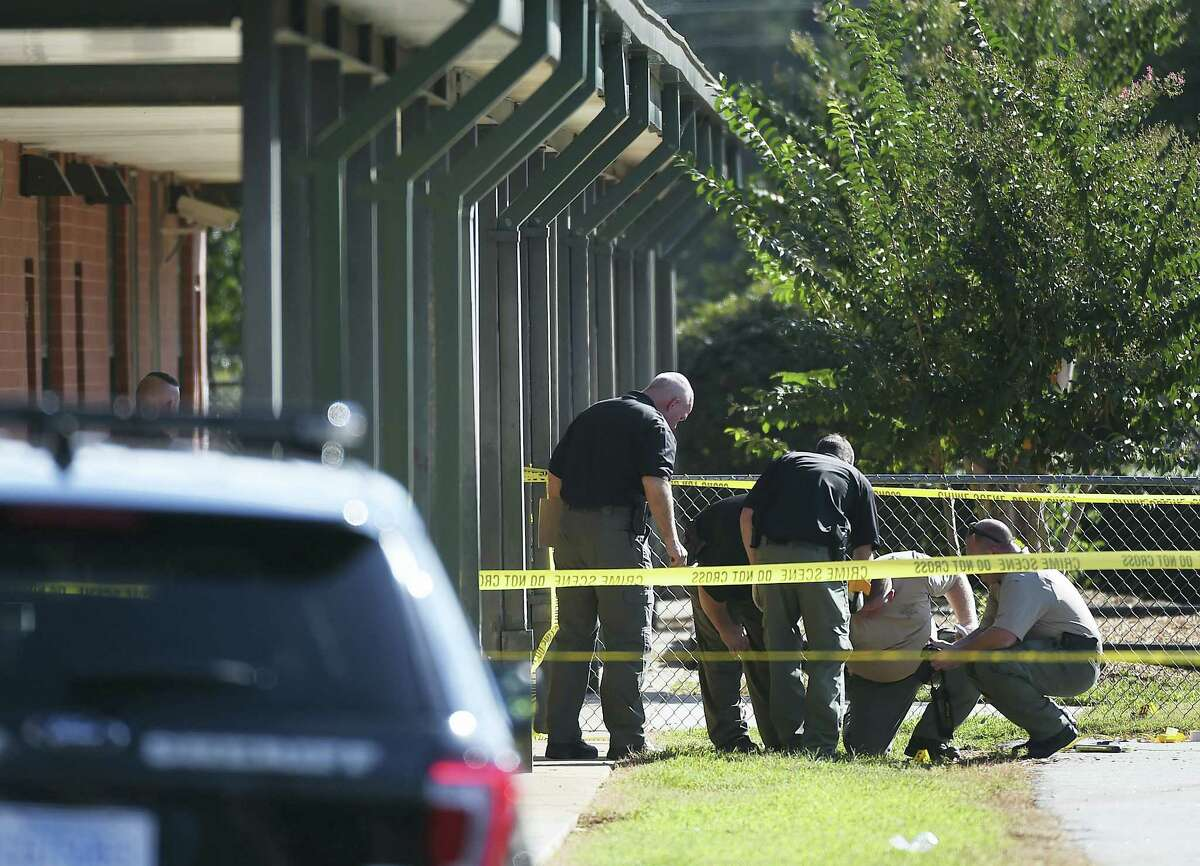 Members of law enforcement investigate an area at Townville Elementary School on Wednesday, Sept. 28, 2016, in Townville, S.C. A teenager opened fire at the South Carolina elementary school Wednesday, wounding two students and a teacher before the suspect was taken into custody, authorities said.