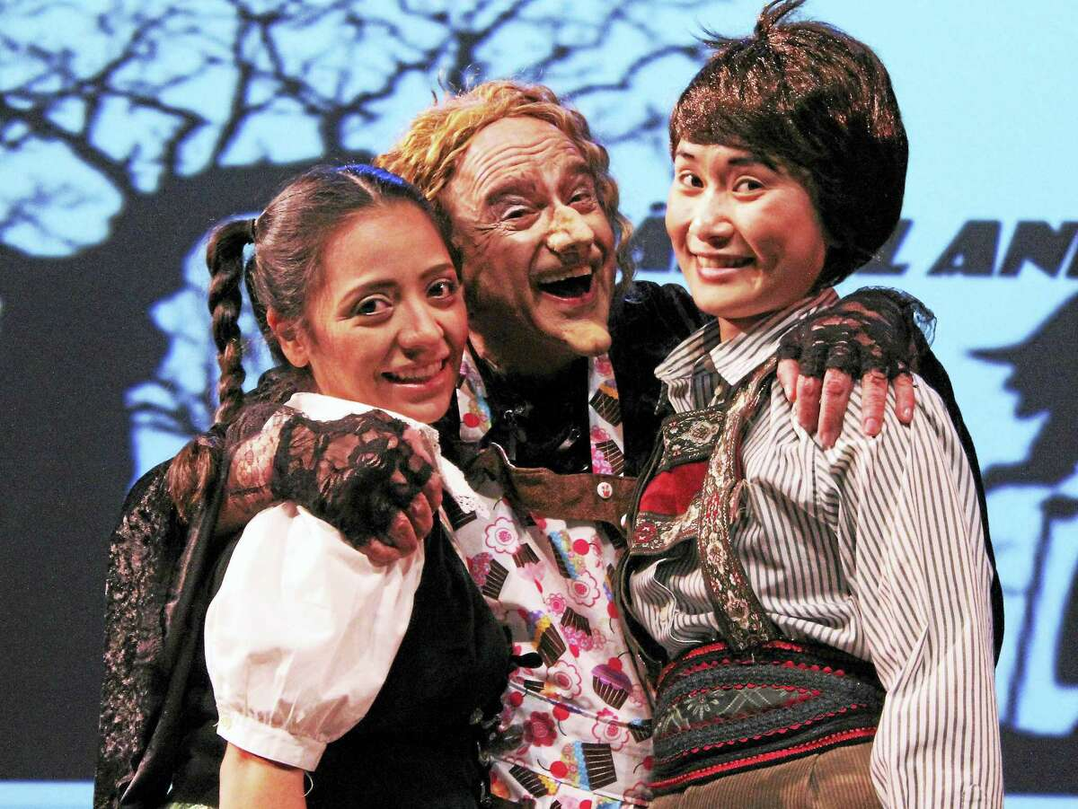 """Nadia Aguilar (Gretel), Anthony Laciura (The Witch) and Evanna Lai (Hansel) in """"Hansel and Gretel"""" in West Hartford."""