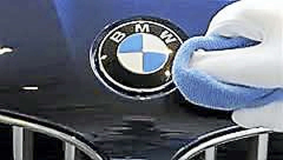 This March 17, 2010, file photo shows a BMW logo being cleaned in Munich.