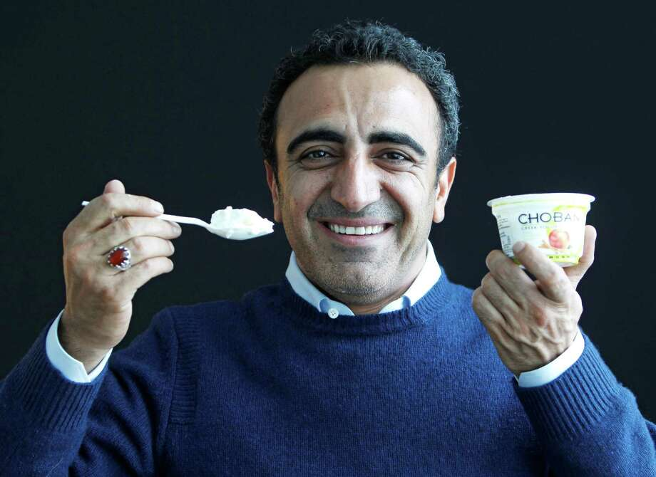In this Jan. 13, 2012 photo, Hamdi Ulukaya, CEO of Chobani Greek Yogurt, poses at the Chobani plant in South Edmeston, N.Y. Greek yogurt now accounts for a quarter of the total yogurt market after a dizzying growth spurt that is especially apparent here in the heart of upstate New York. The nation's No. 1 and No. 2 Greek yogurt brands ó Chobani and Fage, respectively ó are both expanding plants within 60 miles of each other, and another company is building a plant in western New York. The expansions come as the big U.S. yogurt makers are focusing on Greek products, too. Photo: AP Photo/Mike Groll / AP2012