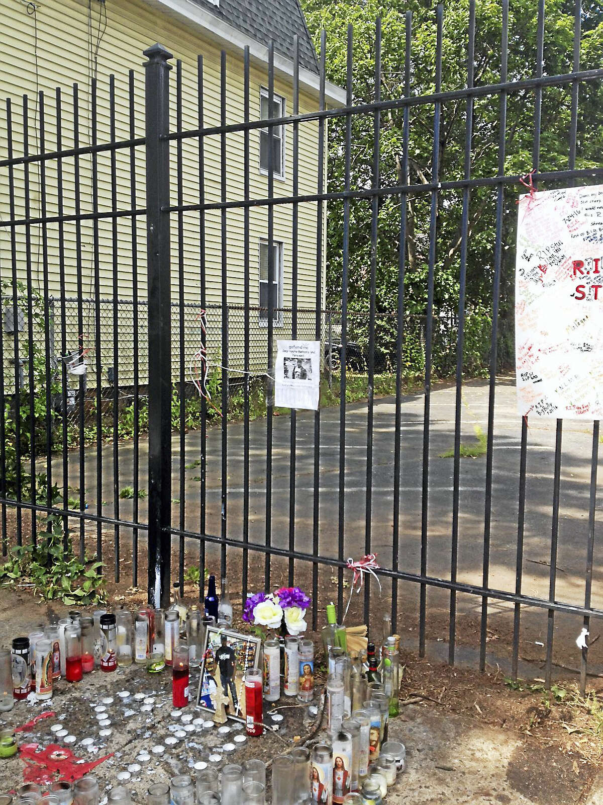 Candles, flowers pay tribute to Daryl Wayne Belton. who was gunned down on Kensington Street Saturday in New Haven.