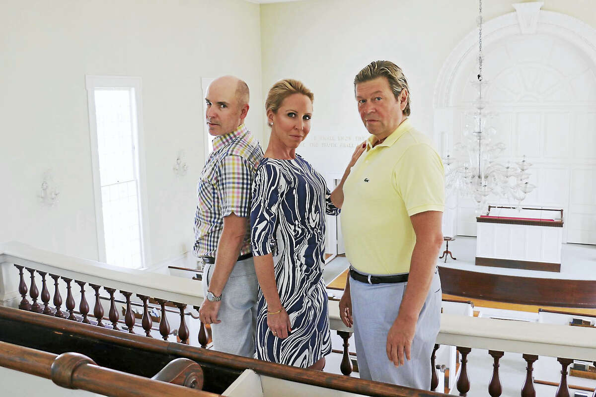 Marc Deaton, right, with Carly Callahan and John Johmann.