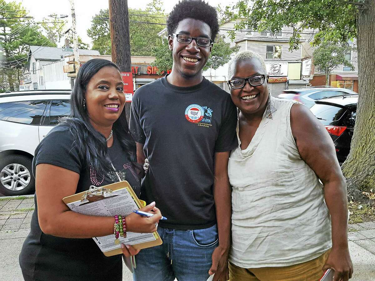 Greater New Haven NAACP branch President Doris Dumas, new voter Gregory Ivy, 18, and resident Babz Rawls Ivy