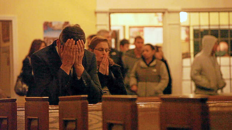 Mourners gather at church after the horrific slayings. Photo: Contributed