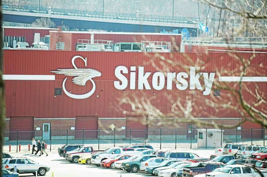Workers walk outside of Sikorsky Aircraft in Stratford. Photo: Douglas Healey — AP File Photo / AP2009