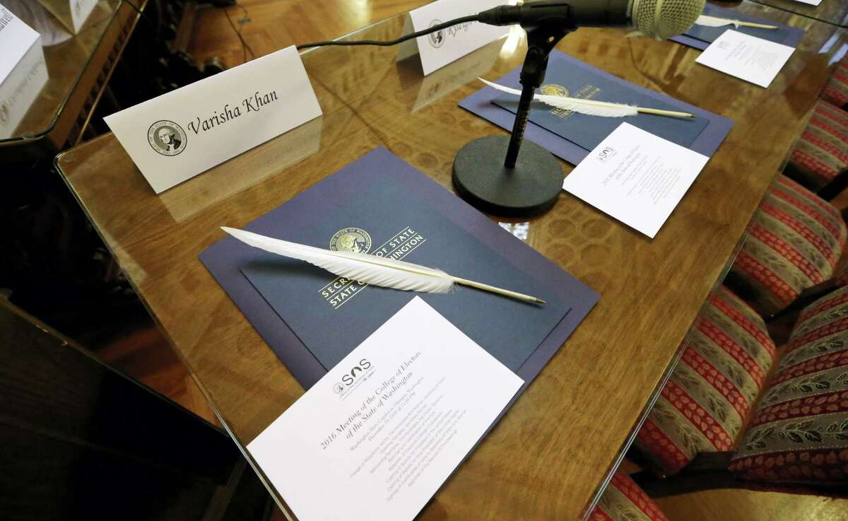 Quill ballpoint pens sit ready for Elector College electors, Monday in Olympia, Wash. Members of Washington state's Electoral College met at noon Monday in the Capitol to complete the constitutional formality.