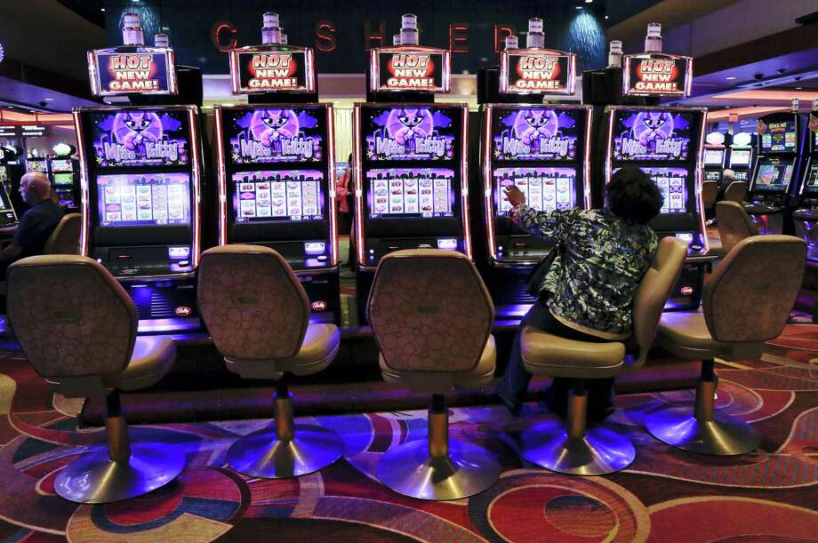 In this Oct. 3, 2014, file photo, a visitor to the Resorts World Casino at the Aqueduct racetrack plays an electronic slot machine, in the Queens borough of New York. The casino said on Nov. 3, 2016, that a woman who was shown that she won nearly $43 million on a penny slot in August 2016 actually won $2.25. Photo: AP Photo/Julie Jacobson, File    / Copyright 2016 The Associated Press. All rights reserved.