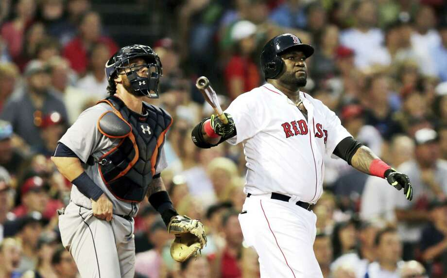 Boston Red Sox designated hitter David Ortiz watches his three-run home run during the third inning of Boston's 9-8 loss to the Tigers on Tuesday. Photo: Charles Krupa — The Associated Press   / AP