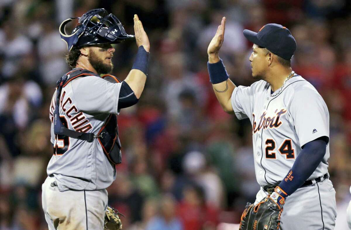 Detroit Tigers catcher Jarrod Saltalamacchia, left, high-fives first baseman Miguel Cabrera after the Tigers defeated the Red Sox 9-8 at Fenway Park Tuesday in Boston.