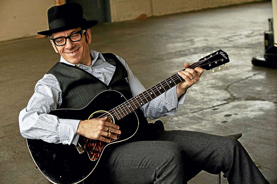 Elvis Costello with guitar. Photo: Photo Courtesy Of Shore Fire Media   / James_O'Mara