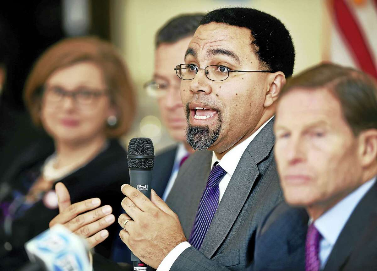 U.S. Secretary of Education John B. King Jr. speaks at a roundtable discussion about New Haven's Youth Stat program at Wilbur Cross High School in New Haven Monday.