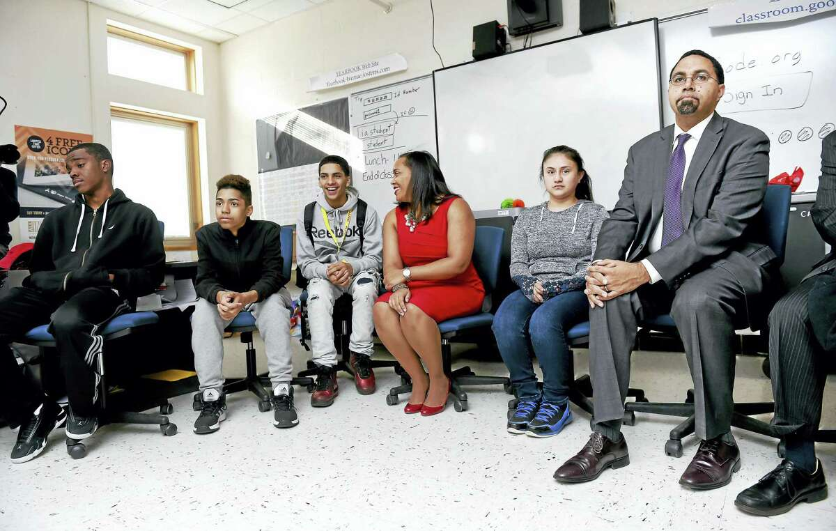 U.S. Secretary of Education John B. King Jr., far right, watches students from the Strong Program and a focus group better understand stress at Wilbur Cross High School in New Haven Monday. Students in the Strong Program who meet after school invited other students to participate in a weekly focus group to better understand and combat stressors that effect high school performance. At center is Principal Edith Johnson.