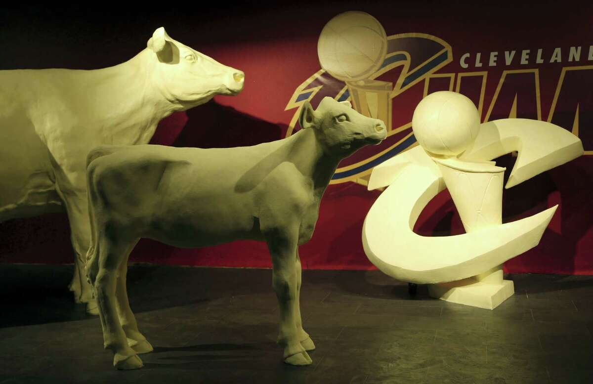 This July 18, 2016 photo provided by The American Dairy Association Mideast shows some of the butter sculptures honoring the Cleveland Cavaliers' NBA basketball championship team at the Ohio State Fair in Columbus, Ohio. The fair opens Wednesday, July 27, 2016.