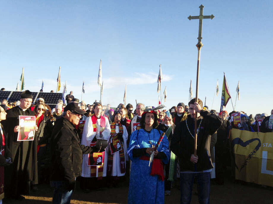 Members of the clergy join protesters against the Dakota Access oil pipeline in southern North Dakota near Cannon Ball on Thursday, Nov. 3, 2016, to draw attention to the concerns of the Standing Rock Sioux and push elected officials to call for a halt to construction. The tribe says the $3.8 billion, four-state pipeline threatens its drinking water and cultural sites. Photo: AP Photo/James MacPherson    / Copyright 2016 The Associated Press. All rights reserved.