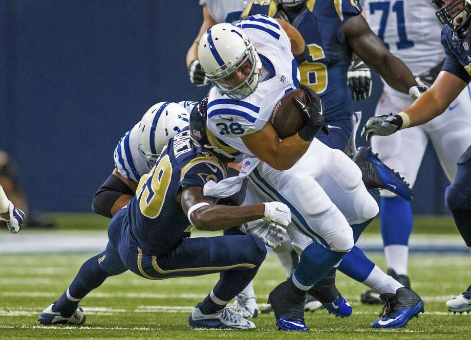Indianapolis Colts running back Tyler Varga (38) dives forward during an NFL game against the St. Louis Rams on Saturday Aug. 29, 2015 at the Edward Jones Dome in St. Louis. (AP Photo/TUSP, Jay Biggerstaff) Photo: AP / FR170979 AP